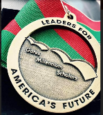 Gates Millennium Scholars A brass medallion and red ribbon with white border and lettering