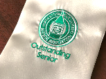 NSU Outstanding Seniors A silver stole with green and white Alumni Association Outstanding Senior logo