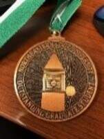 Outstanding Graduate Student A bronze with green medallion and white ribbon, presented during the commencement ceremony