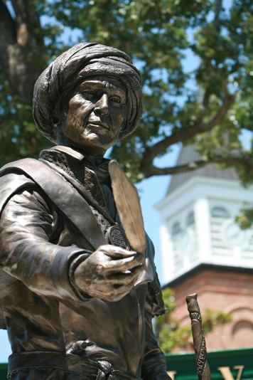 Image of Sequoyah statue holding the feather pen of knowledge