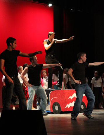 Image of students participating in Greek Sing.